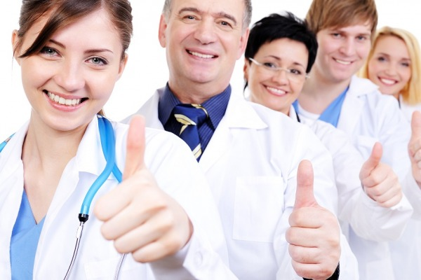 group of happy laughing doctors with gesture thumbs-up standing in line