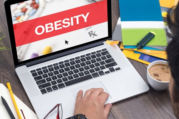 OBESITY CONCEPT ON LAPTOP SCREEN